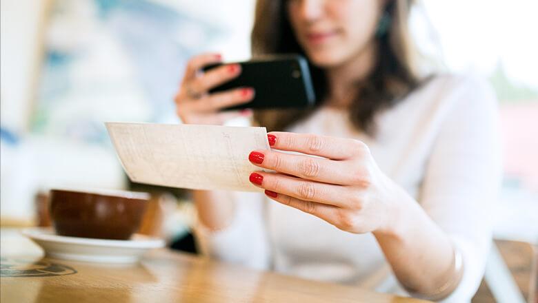woman mobile depositing check